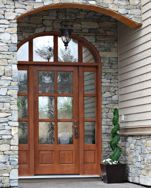 Elegant front door of a brand new executive home.